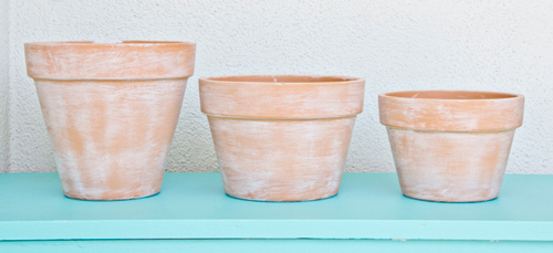 Turn clay garden pots into weather faux pottery
