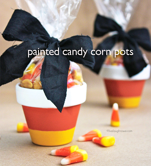 Painted Flowerpots that look like Candy Corn for Halloween