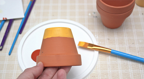 DIY Project for painted candy corn flowerpots